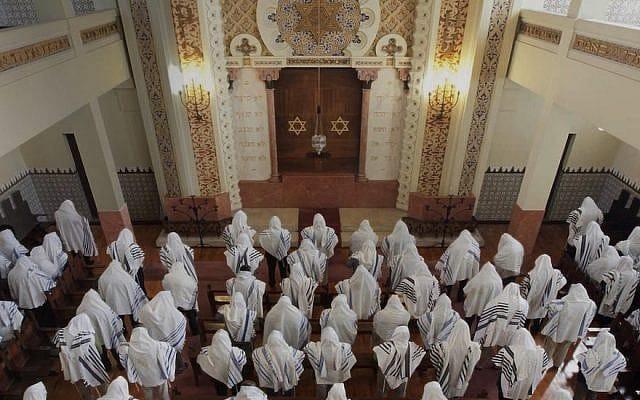 Congregants praying at the Kadoorie – Mekor Haim synagogue in Porto, Portugal
